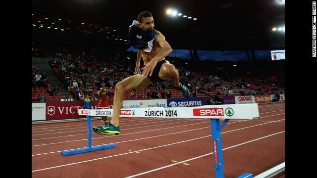 France's Mahiedine Mekhissi-Benabbad leaps over the final barrier on his way to winning the 3,000-meter steeplechase final Thursday, August 14, at the European Athletics Championships in Zurich, Switzerland. But he was later disqualified for his shirtless celebration in the last stretch of the race.