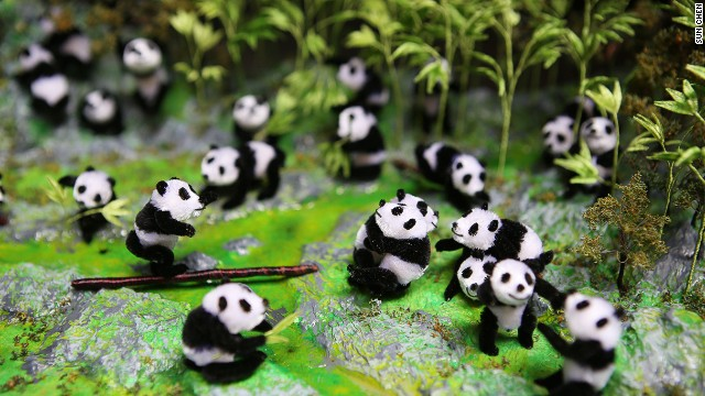 This panda scene was made by Nanjing velvet-flower artist Zhao Shu-xian. The Chinese word for velvet flowers refers to all figures made from thin copper sticks covered with silk velvet. Nanjing is the birthplace of many of the country's traditional arts.