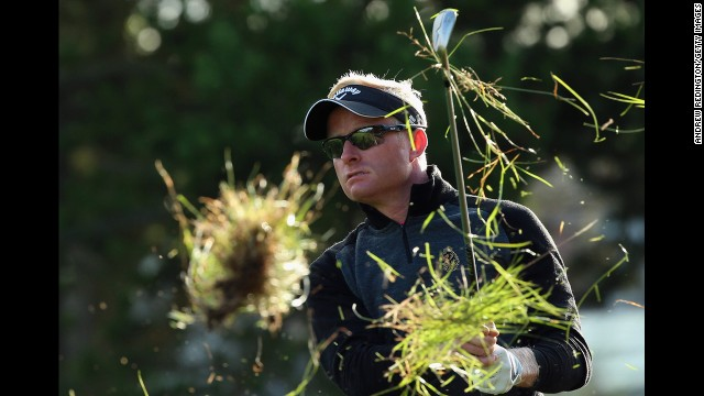 Grass flies in the air as golfer Simon Dyson hits a shot Friday, August 15, during the European Tour event in Aalborg, Denmark.