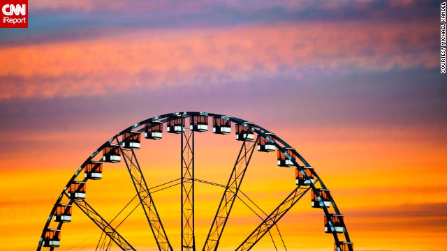 A setting sun fills the sky with color above the Roue de Paris. See more beautiful photos of the city on <a href='http://ireport.cnn.com/docs/DOC-1097498'>CNN iReport</a>.