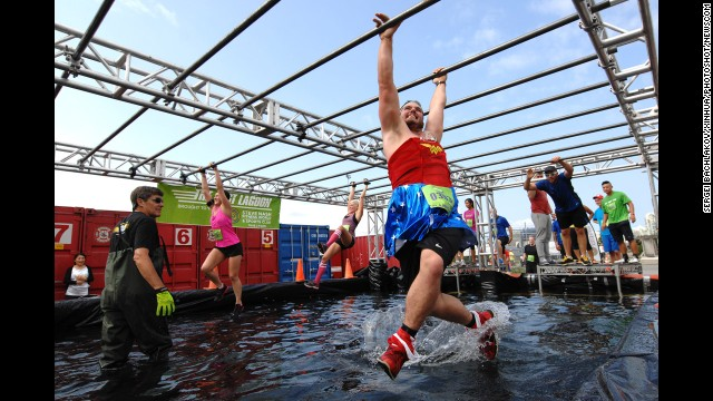 People take part in the annual Concrete Hero obstacle race to raise money for cancer research Sunday, August 17, in Vancouver, British Columbia. More than $550,000 has been raised through the race in the past two years.