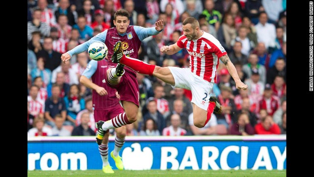Stoke City's Phil Bardsley, right, challenges Aston Villa's Ashley Westwood during their Premier League match Saturday, August 16, in Stoke-on-Trent, England. Aston Villa won 1-0. See 30 amazing sports photos from last week