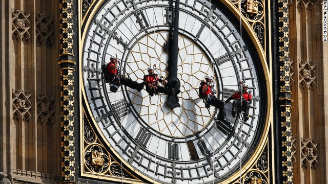 "AUGUST 18 - LONDON, ENGLAND: Workers hang in front of the clock face of Big Ben as they clean the city's landmark timepiece at the Houses of Parliament in Westminster. <a href='http://cnn.com/2013/10/15/world/europe/big-ben-fast-facts/'>The name ""Big Ben"" originally referred to just the bell of the clock,</a> but has also come to indicate the clock, the tower and the bell."