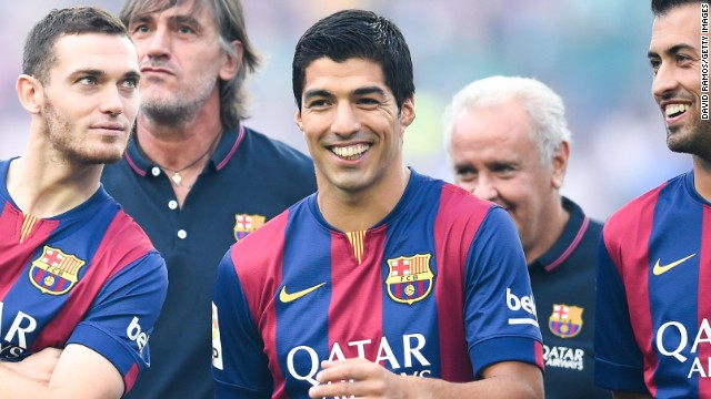 Luis Suarez, center, not Thomas Vermaelen, left, or Sergio Busquets, right, stole the spotlight Monday at the Camp Nou.