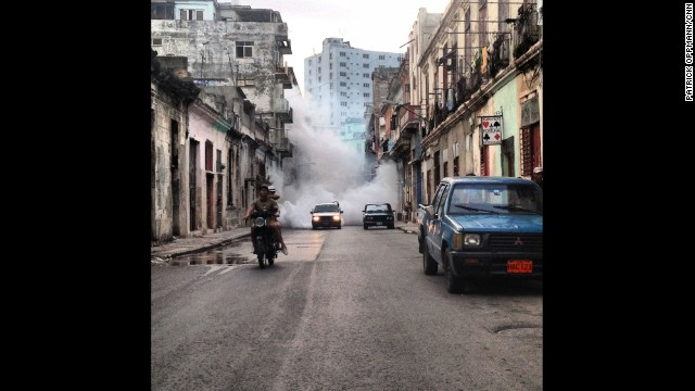 "HAVANA, CUBA: ""Trying to outrun the fumigation truck. Attempting to control the outbreak of dengue, Cuban health authorities blitz whole neighborhoods with chemicals that supposedly kill the mosquitoes spreading the disease."" - CNN's Patrick Oppmann. Follow Patrick (<a href='http://instagram.com/cubareporter' target='_blank'>@cubareporter</a>) and other CNNers along on Instagram at <a href='http://instagram.com/cnn' target='_blank'>instagram.com/cnn</a>."