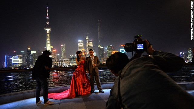 A Chinese couple poses for their wedding photos on Shanghai's Bund. Divorce rates in China have soared in recent years.