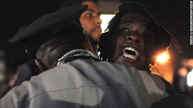 A demonstrator shouts during a protest on West Florissant Avenue, one of Ferguson's main streets, on August 18.