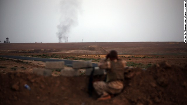 A fighter with Kurdish Peshmerga forces battles ISIS militants near Mosul, Iraq, on Monday, August 18.