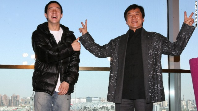 Jackie Chan (right) poses with his son Jaycee in 2009 outside Beijing's