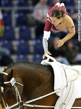 Vaulting is one of the World Equestrian Games' more flamboyant events, in which athletes perform gymnastics on the back of a horse. Here is Marion Graf of Switzerland in action.