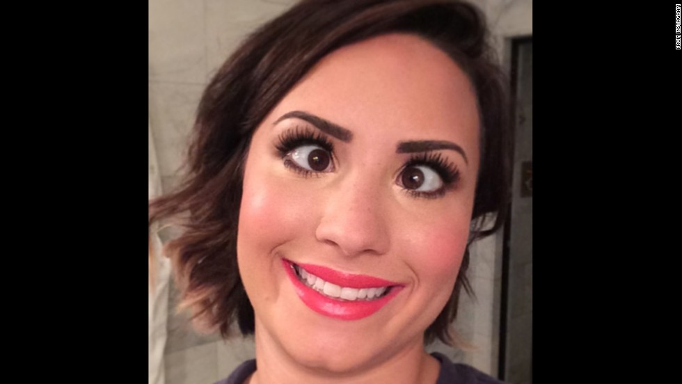 "Actress and singer Demi Lovato <a href='http://instagram.com/p/rvOGfAuKk0/' target='_blank'>posted this silly selfie</a> to Instagram on Friday, August 15, with the message: ""6 am glamour-puss."" She included the hashtag ""#votedemilovato"" as her ""Really Don't Care"" video is <a href='http://www.mtv.com/ontv/vma/2014/best-lyric-video/ ' target='_blank'>up for an MTV Video Music Award.</a>"