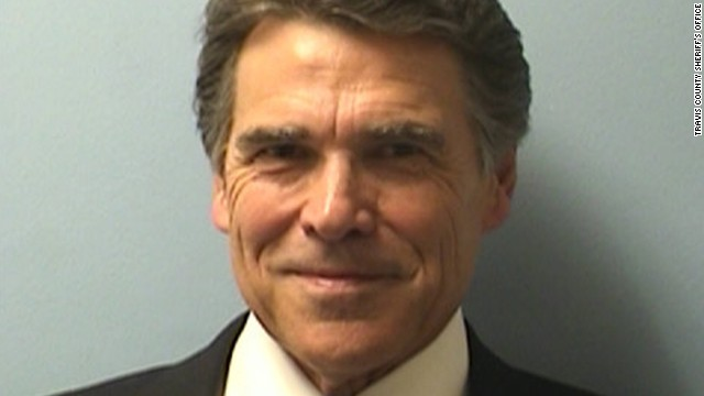 Perry was booked on Tuesday on two felony charges related to his handling of a local political controversy. He vowed to fight the charges.