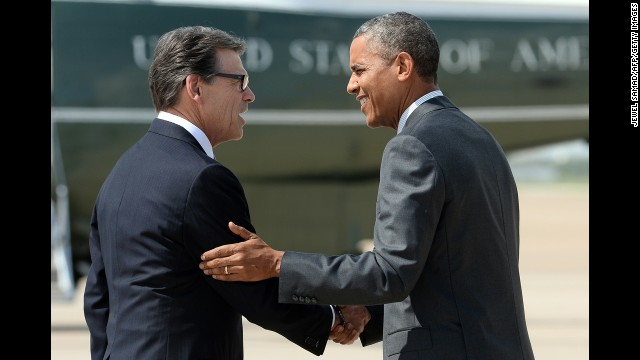 Perry greets President Barack Obama as he arrives in Dallas on July 9, 2014, for a meeting with local elected officials and faith leaders about the humanitarian situation at the Southwest border.