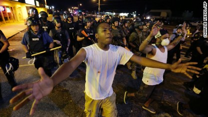 Ferguson streets calm until bottles flew