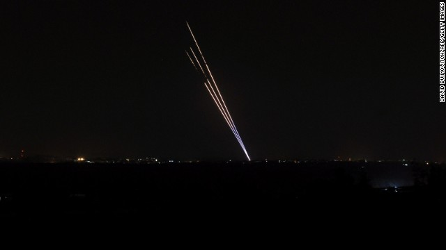Light trails made by rockets fired from the Gaza Strip stand out against the night sky on Tuesday, August 19. Despite efforts to come to a peaceful agreement, Gaza militants launched rockets into Israel on Tuesday, and Israel responded with its own rockets.