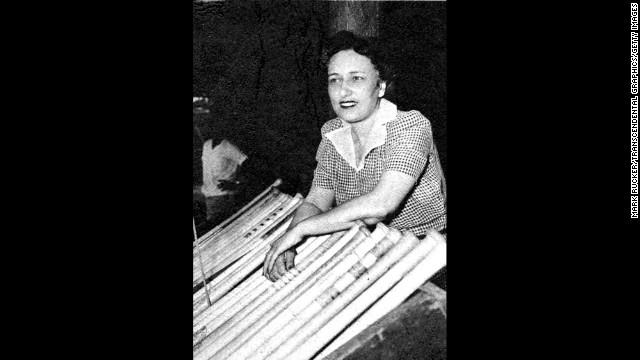 Negro League Newark Eagles baseball team owner Effa Manley poses with bats in the dugout in Ruppert Stadium in Newark, New Jersey, in 1948. Manley was the first woman elected and inducted to the Baseball Hall of Fame.
