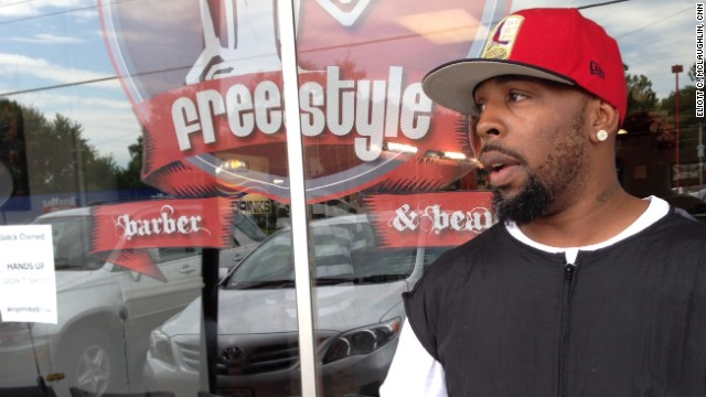 Mike Knox has been staying at his barbershop until 4 a.m during the Ferguson protests to ward off looters.