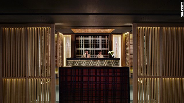 Designers of Ritz-Carlton, Kyoto infused the character and aesthetic of a traditional Meiji house and courtyard into the architectural structure of the building, as seen here at the front desk.
