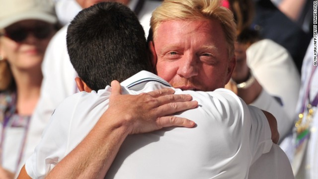 Boris Becker hugs Novak Djokovic after the Serbian wins the first grand slam under his guidance as coach, beating Roger Federer in a thrilling Wimbledon final in July.