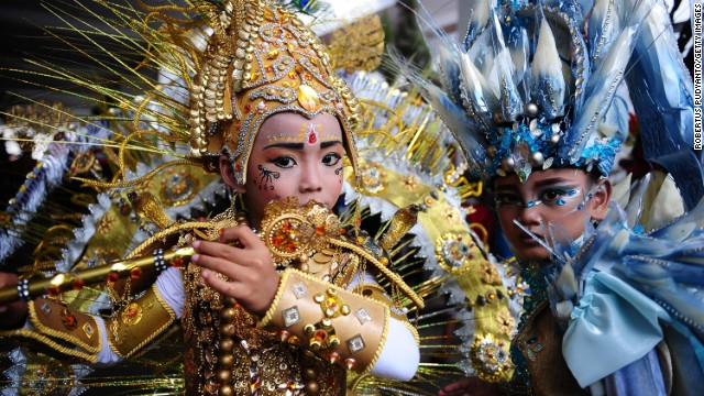 "AUGUST 21 - JEMBER, INDONESIA: Elaborate costumes are on display during the children's version of the 13th Jember Fashion Carnival. The theme this year is ""Triangle, Dynamic in Harmony"" and consists of 10 processions. The street carnival is claimed to be one of the biggest in the world and comprises of more than 850 performers parading along a 3.6km road."
