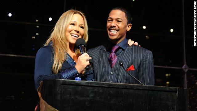 "The couple shared a love of the holiday season. Here, they speak at the listening party for Carey's holiday album ""Merry Christmas II You"" in 2010 in New York."