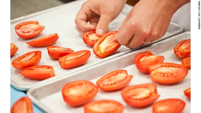 Slow-roast the tomatoes on rimmed baking sheets, which will contain any runaway liquid; for easy cleanup, line the baking sheets with parchment paper or aluminum foil. Distribute half of the tomatoes (cut-side up) on each sheet.