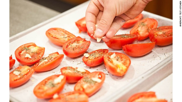 Scatter the chopped garlic evenly over the tomatoes. Don't fret about being too exact—just look for a fairly even distribution.