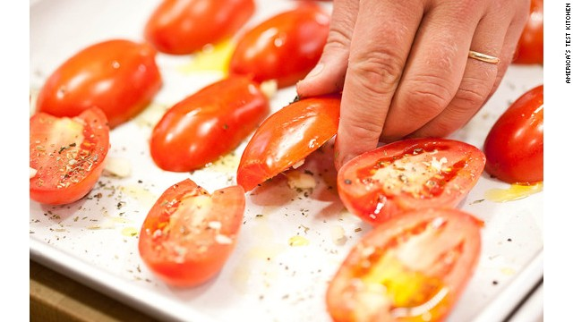 Flip the seasoned tomatoes over, cut-side down.