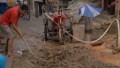 Parched residents dig wells