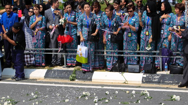 Flowers were thrown onto the street as the hearses passed.