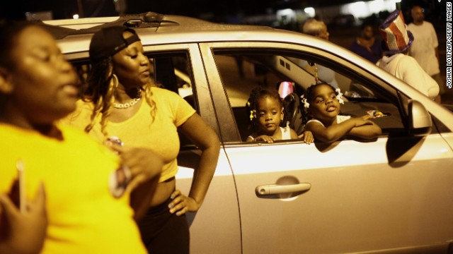 A crowd gathers in Ferguson on August 21. With the situation appearing to calm, Gov. Jay Nixon ordered the Missouri National Guard to begin withdrawing from the city.
