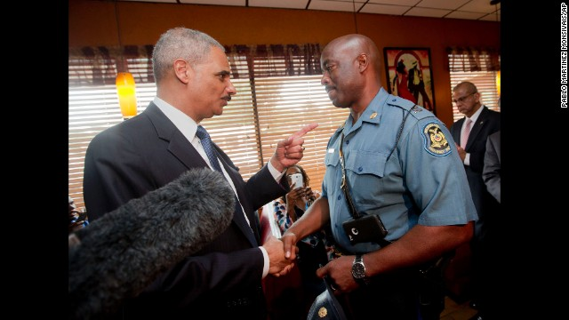 U.S. Attorney General Eric Holder meets with Capt. Ron Johnson of the Missouri State Highway Patrol at a Ferguson restaurant on August 20. Holder came to Missouri to talk to community leaders and review the federal civil rights investigation into Brown's shooting.
