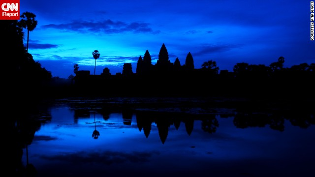 Hundreds of tourists flock to the ancient city of <a href='http://ireport.cnn.com/docs/DOC-1027386'>Angkor Wat</a> in Cambodia each morning to watch the sun rise over its iconic temple.