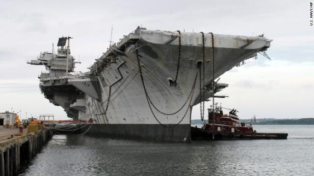 "In this photo released by the U.S. Navy, a tugboat works alongside the decommissioned aircraft carrier USS Saratoga on Thursday, August 21, in Newport, Rhode Island. The Navy has paid a Texas recycling company a penny to dispose of the Saratoga, part of the Forrestal-class of ""supercarrier"" vessels built for the Atomic Age. The carrier was decommissioned 20 years ago. Click through the gallery to see photos of aircraft carrier classes throughout American history:"