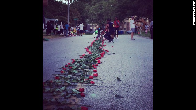 "FERGUSON, MISSOURI: ""A group now silently placing a trail of roses down the street from the memorial to Mike Brown."" - CNN's Stephanie Elam, August 21. There are dueling narratives in the death of Michael Brown: one says he was holding his hands up in surrender as officer Darren Wilson shot him, and the other says Brown was the aggressor, and Wilson shot as Brown was rushing toward him. Investigators will certainly use high-tech tools to try to get to the truth, but they'll also use a tool as old as the ancient Greeks: the autopsy. <a href='http://www.cnn.com/2014/08/21/health/michael-brown-autopsies/index.html?hpt=hp_inthenews'>FULL STORY AT CNN.COM</a>. Follow Stephanie (<a href='http://instagram.com/stephelamtv' target='_blank'>@stephelamtv</a>) and other CNNers along on Instagram at <a href='http://instagram.com/cnn' target='_blank'>instagram.com/cnn</a>."