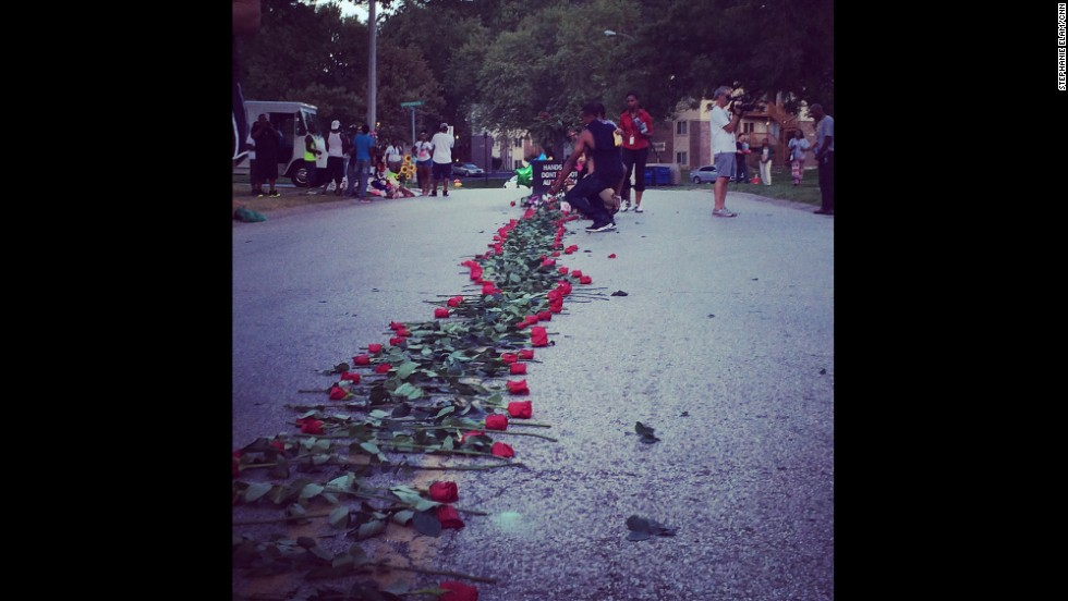 """FERGUSON, MISSOURI: """"A group now silently placing a trail of roses down the street from the memorial to Mike Brown."""" - CNN's Stephanie Elam, August 21. There are dueling narratives in the death of Michael Brown: one says he was holding his hands up in surrender as officer Darren Wilson shot him, and the other says Brown was the aggressor, and Wilson shot as Brown was rushing toward him. Investigators will certainly use high-tech tools to try to get to the truth, but they'll also use a tool as old as the ancient Greeks: the autopsy. <a href='http://www.cnn.com/2014/08/21/health/michael-brown-autopsies/index.html?hpt=hp_inthenews'>FULL STORY AT CNN.COM</a>. Follow Stephanie (<a href='http://instagram.com/stephelamtv' target='_blank'>@stephelamtv</a>) and other CNNers along on Instagram at <a href='http://instagram.com/cnn' target='_blank'>instagram.com/cnn</a>."""