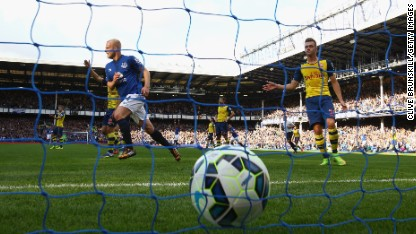 Football: Arsenal rescue point at Everton