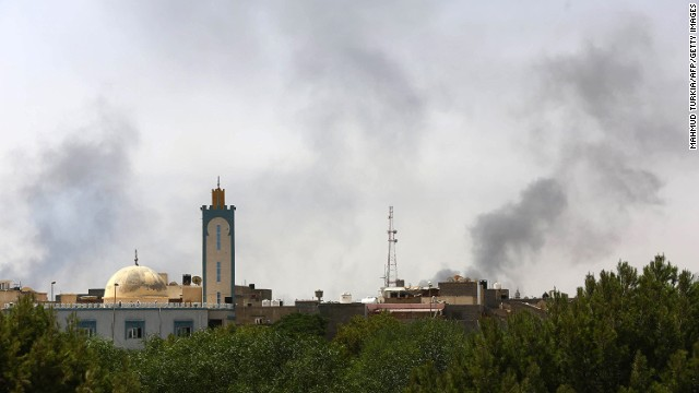 Black smoke is seen rising in the area of Tripoli International Airport where clashes have raged between Libyan militias.
