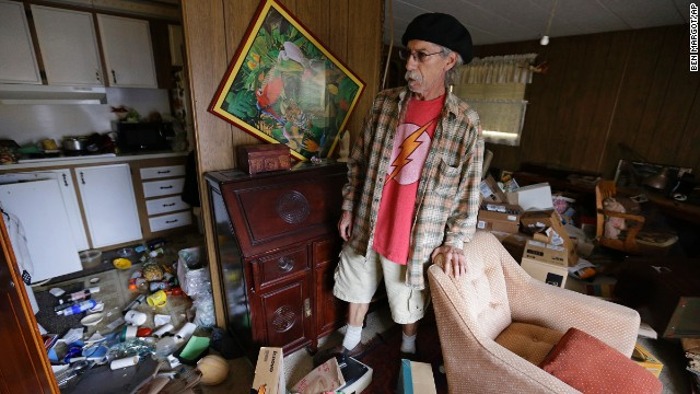 Steve Brody inspects damage to the interior of his mobile home at the Napa Valley Mobile Home Park on August 24 in Napa.