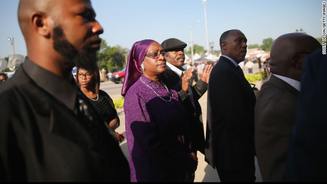 Mourners wait in line to enter the chu