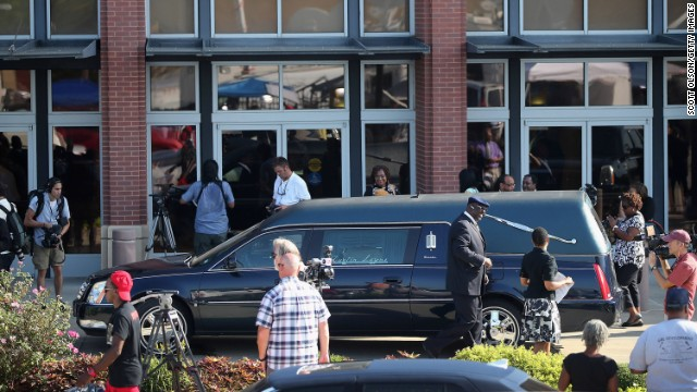 A hearse sits outside the church before the funeral.