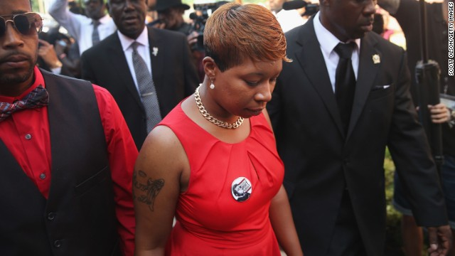 Brown's mother, Lesley McSpadden, arrives at Friendly Temple Missionary Baptist Church for the funeral service.