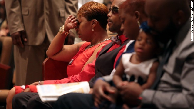 Lesley McSpadden, Brown's mother, sits during the funeral on August 25.
