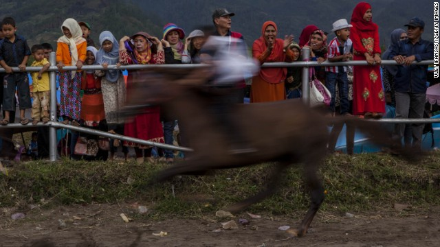 AUGUST 25 - CENTRAL ACEH, INDONESIA: Acehnese spectators watch the Takengon traditional horse races. Young jockeys ride bareback during the races that mark Indonesian independence.