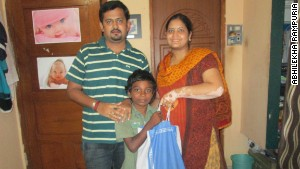 Abhilekha Rampuria (right) gives a boy, Balaji, 5kgs of rice. She says: \