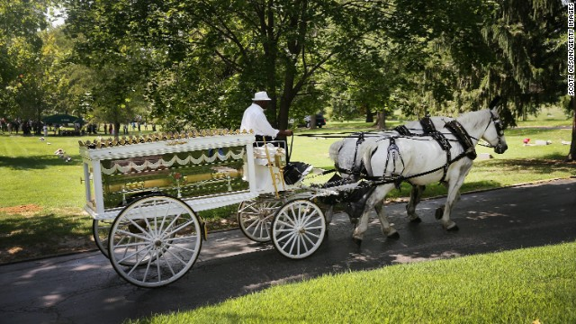 Michael Brown's casket arrives at St. Peter's Cemetery on Monday, August 25. Brown, 18, was shot and killed by police Officer Darren Wilson on August 9 in Ferguson, Missouri. Brown's death sparked protests in the St. Louis suburb, and a national debate about race and police actions.