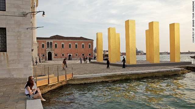 The Venice Biennale has spawned a huge selection of art exhibitions and architectural displays across the city beyond the <a href='http://edition.cnn.com/2014/06/16/travel/venice-architecture-biennale-rem-koolhaas/'>ticketed barriers of the Giardini</a>. World renowned artists are experimenting within various historical interiors and waterfronts across Venice. Heinz Mack's gold pillars are pictured next to Palladio's Church.
