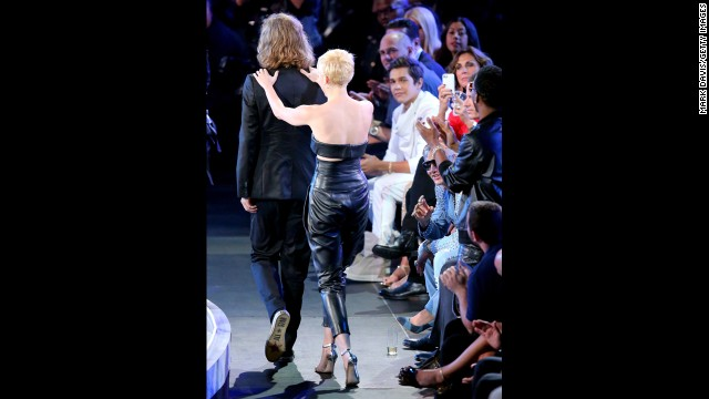 "No one is quite sure what Cyrus is up to as she marches Helt up to the stage after she was named the winner of the Video of the Year for her single ""Wrecking Ball."""