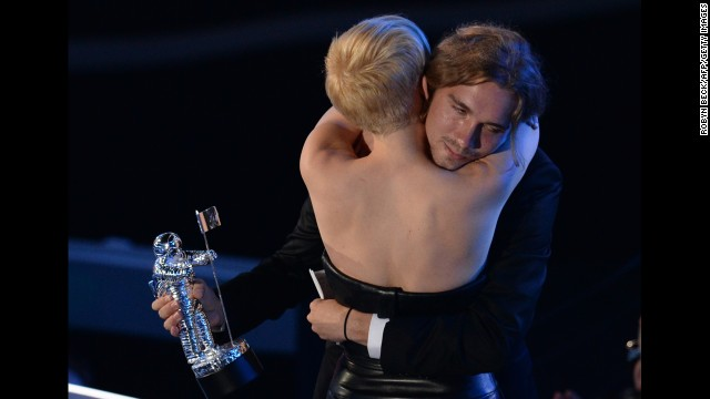 "Cyrus and Helt embrace following his acceptance speech given on behalf of the singer who won Video of the Year for ""Wrecking Ball"" during the 2014 MTV Video Music Awards."