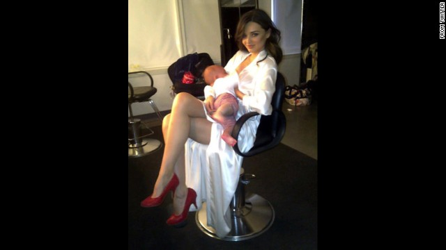 "Model Miranda Kerr has shared a couple of photos of herself breastfeeding her son Flynn. She tagged this one ""<a href='https://twitter.com/MirandaKerr/status/63659011983147009' target='_blank'>Another day in the office</a>."""